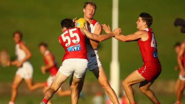 Grounded: Callum Mills is tackled during the Swans' intra-club trial at Henson Park last month.