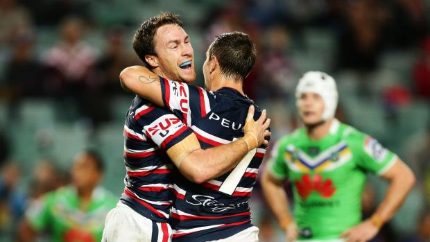Perspective: James Maloney embraces former halves partner Mitchell Pearce.