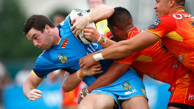 Connor Broadhurst of the Titans is tackled during the NRL trial match against the New Zealand Warriors.