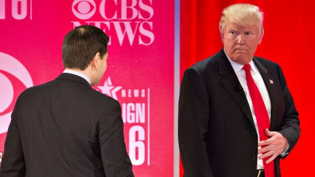 Donald Trump looks toward Senator Marco Rubio during a break at the Republican presidential candidate.