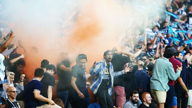 Fanning the flames: Melbourne Victory fans set off a flare during Saturday's Melbourne derby.