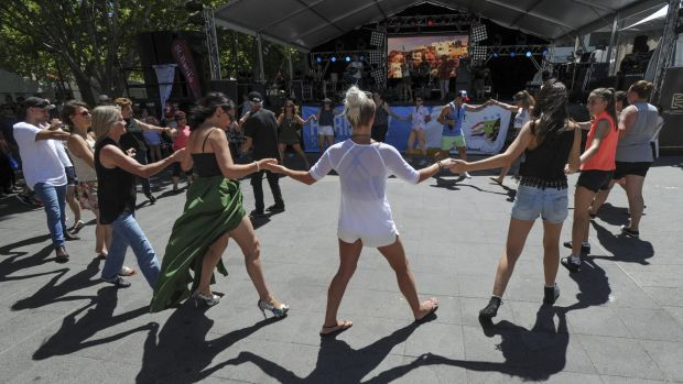 People get into the swing of the festival with Greek dancing in front of the Greek Glendi stage in Garema Place.