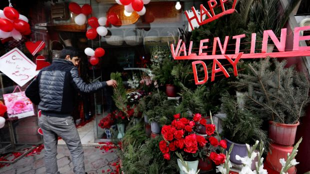 Love amid the carnage: an Afghan flower vendor arranges roses for Valentine's Day in Kabul.