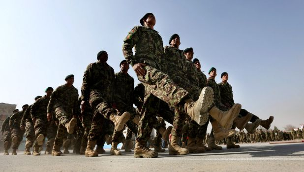 New members of the Afghan National Army march during their graduation ceremony at the Afghan Military Academy in Kabul ...