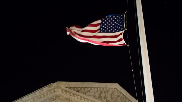 A US flag flies at half-staff in front of the US Supreme Court in Washington on Saturday evening.