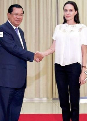Angelina Jolie  is greeted by Cambodian Prime Minister Hun Sen.