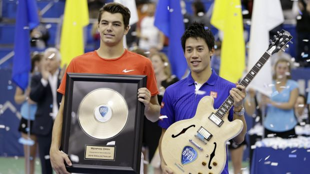 Kei Nishikori, right, and Taylor Fritz pose with their trophies.