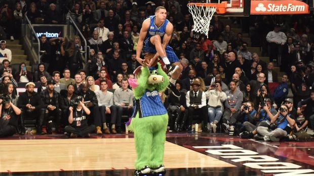 Mascot manoeuvres: Orlando Magic forward Aaron Gordon defies gravity in Toronto.