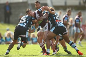 Comeback trail: Brenton Lawrence is tackled during last weekend's trial against Cronulla.