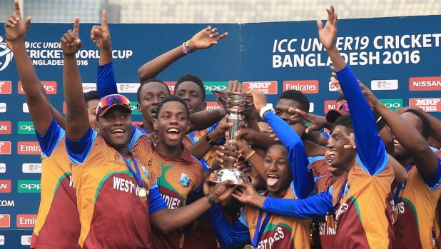 Champions: West Indies players celebrate after winning the ICC Under-19 Cricket World Cup final  against India in Dhaka.