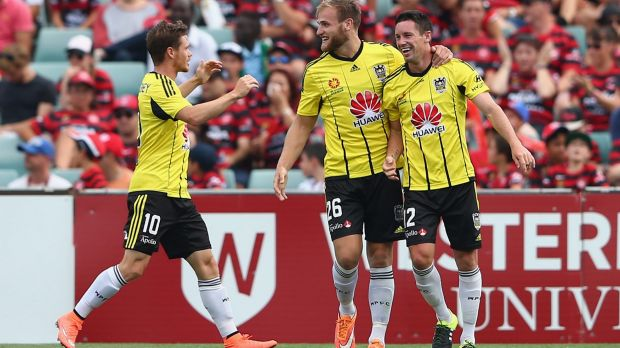 Super striker: Blake Powell celebrates scoring a goal for the Phoenix in the shock win over the Wanderers on Sunday.