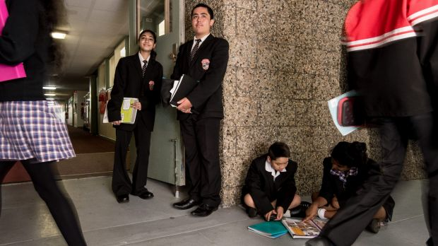 Poor school: Government funding is up six per cent at Noble Park Secondary College. Junior school captains (from left) ...