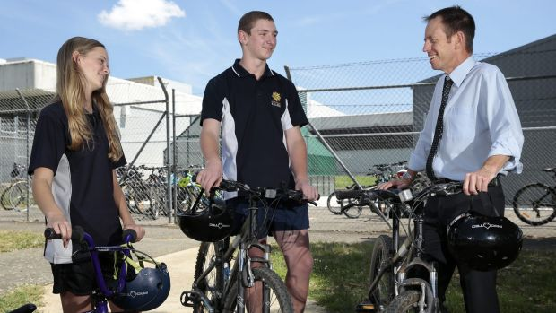 University of Canberra High School year 10 students Hannah Pengilly and Thomas D'Arx chat with Minister for Road Safety ...