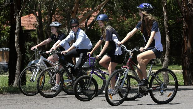 Road Safety Minister Shane Rattenbury rides with students at University of Canberra High School in Kaleen.