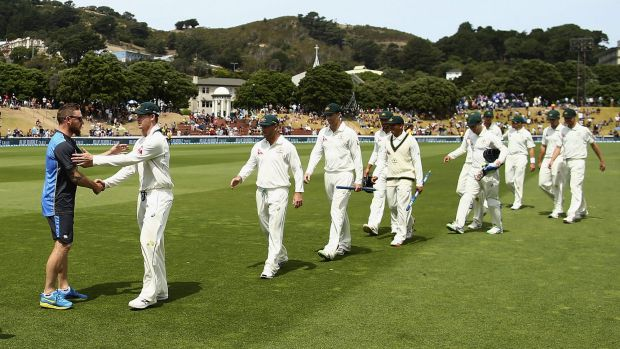 Job half done: Brendon McCullum congratulates Steve Smith after day four of the Test between New Zealand and Australia ...