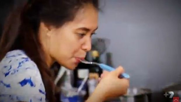 Hot, hot, hot ... My Kitchen Rules competitor Tasia does a taste test to she if she has added enough spice to the dish.