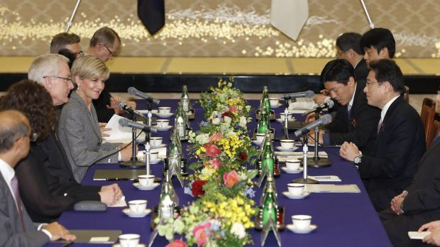 Australian Foreign Minister Julie Bishop, fourth from left, talks with her Japanese counterpart Fumio Kishida, right, at ...