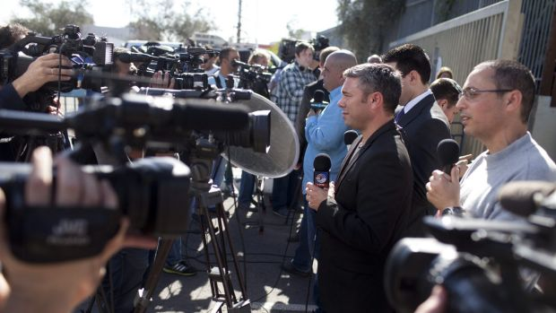 The media pack at the entrance to Maasiyahu Prison for the arrival of former Israeli prime minister Ehud Olmert .