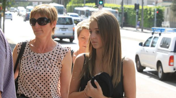 Paul Smith's wife Karen (left) arrives at Glebe Coroner's Court.