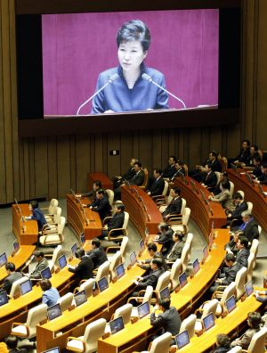 A huge screen shows Ms Park delivering her speech on Tuesday.