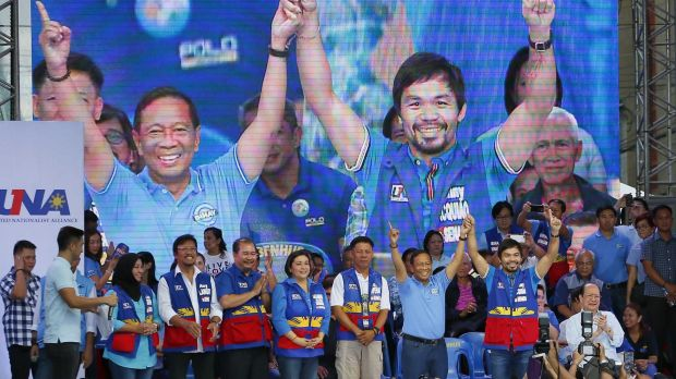 Philippine Vice President Jejomar Binay, second from right, raises the hands of senatorial candidate, boxer and ...