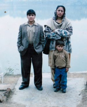 Maria Toorpakai Wazir when she was living as a boy, with her mother, Aami, and her younger brother.