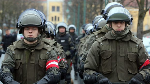 Austrian soldiers practice protecting the border between Slovenia and Austria in Strass on Tuesday.