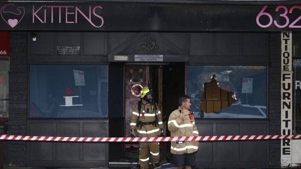 Firefighters outside the Kittens strip club in South Caulfield after it was bombed on Tuesday morning.