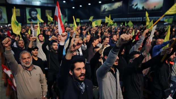 Supporters cheer as they listen to a speech by Hezbollah leader Sayyed Hassan Nasrallah, in Beirut, Lebanon, on Tuesday. ...