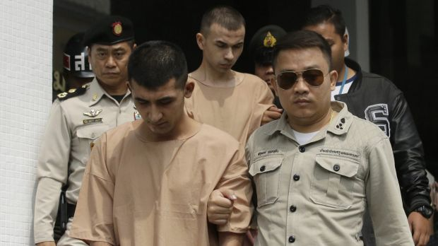 Thai corrections officers escort Yusufu Mieraili, left, and Adem Karadag, rear, from a military court in Bangkok on Tuesday.