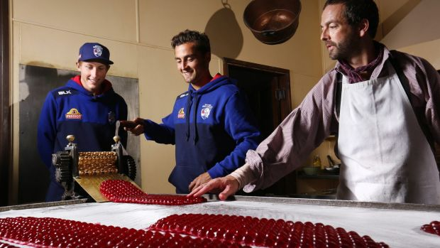 Bailey Dale, Dahlhaus and confectioner Ben Bignell make raspberry drops.