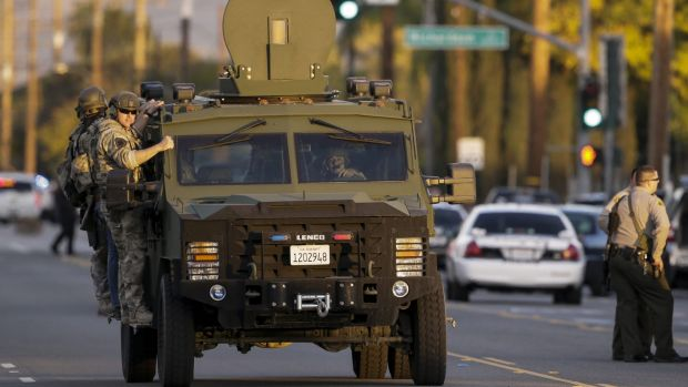 Police hunt for the killers following the shootings in San Bernardino in December.