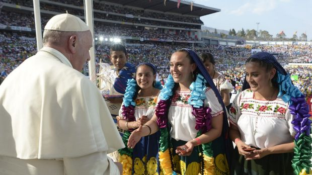 Mexicans wearing traditional costumes greet Pope Francis during a meeting with Mexican youth at Jose Maria Morelos y ...