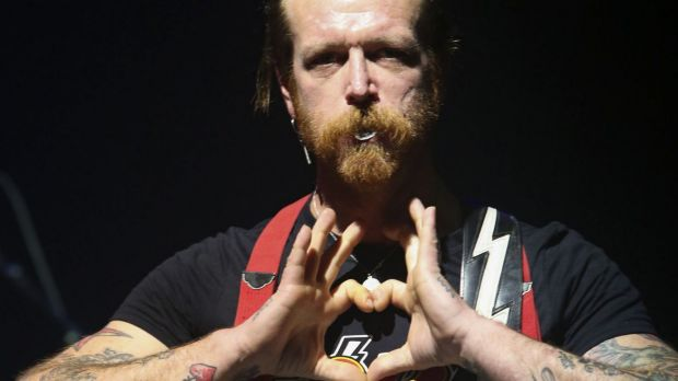 Jesse Hughes, frontman of California rock band Eagles of Death Metal, makes a heart sign as the band performs at the ...