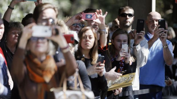 Attendees take photos of Republican presidential candidate Senator Marco Rubio on Tuesday.