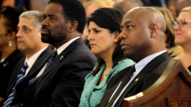 South Carolina Governor Nikki Haley (centre) attends a prayer vigil for the victims of the shooting at Emanuel AME ...