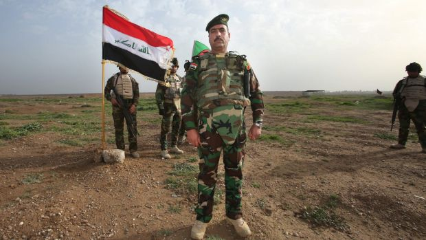 The Commanding Officer from the Iraq Security Forces Nineveh Operations Command-Commando Battalion at Camp Taji, north ...