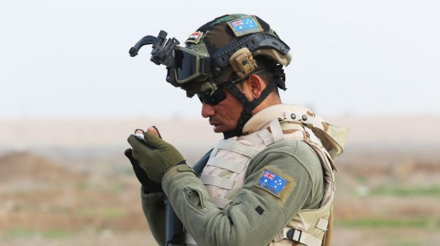 A soldier from the Iraq Security Forces Nineveh Operations Command trained by Australian and New Zealand forces at Camp ...