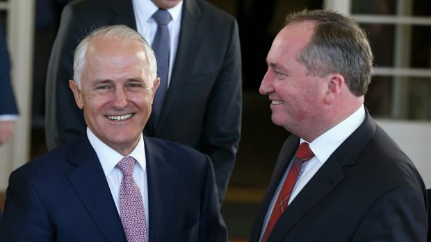 Prime Minister Malcolm Turnbull and Deputy Prime Minister Barnaby Joyce pose for photos after the swearing-in ceremony ...