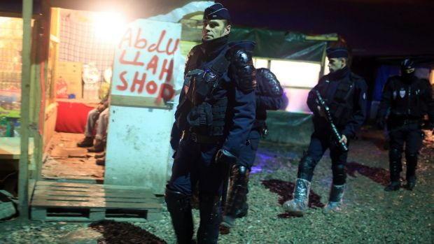 French riot police patrol in the migrant camp in Calais earlier this month.