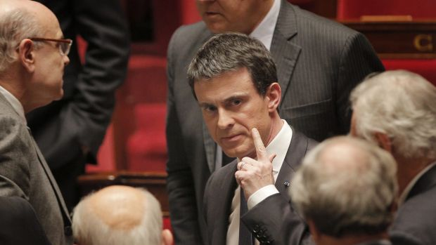 French prime minister Manuel Valls, centre, leaves France's National Assembly, in Paris, last week.