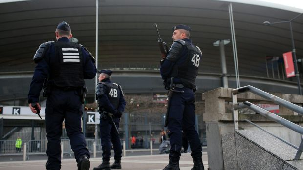 French riot police officers stand guard outside the Stade de France earlier this month.