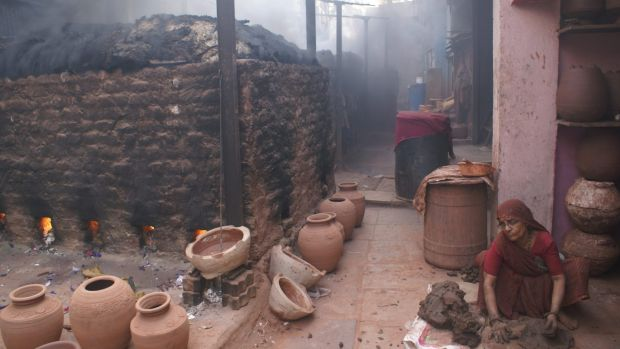 Pottery being prepared for exhibition at the Dharavi slum.