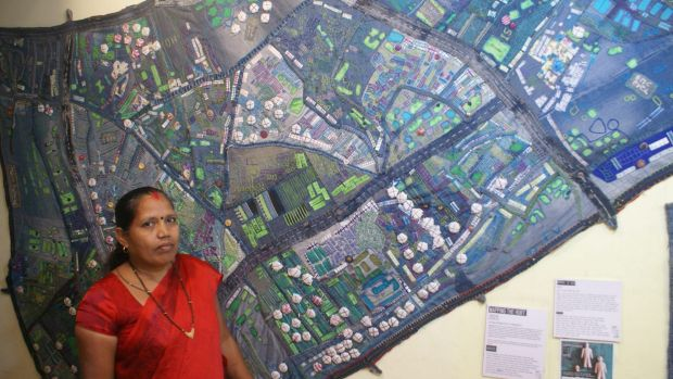 A group of women took scraps of waste denim to create a giant patchwork map of the slum.