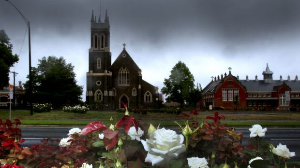 St Alipius Presbytery, a church and old boys' school in Ballarat, has ribbons tied to the fence to pay tribute to the ...