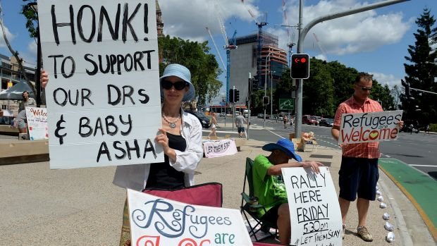 Protesters stand in solidarity with Lady Cilento hospital staff that are refusing to discharge baby Asha.