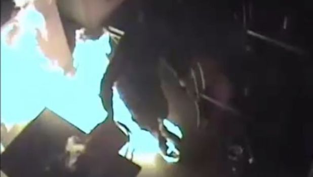 CCTV footage of an arsonist setting his feet on fire in a Richmond cafe on February 10.