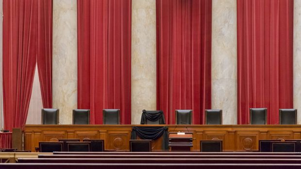Supreme Court Justice Antonin Scalia's courtroom chair is draped in black to mark his death as part of a tradition that ...