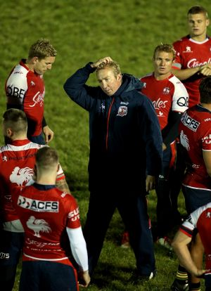 A lot on his plate: Trent Robinson looks on during a training session in Warrington.