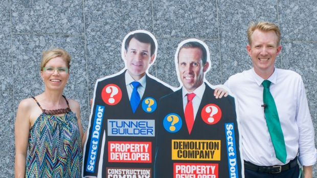 Greens lord mayoral candidate Ben Pennings and Jamboree ward candidate Dorotee Braun paraded a cardboard cutout to ...